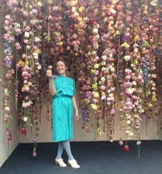 Flowers, Love and Money by Rebecca Louise Law Site-specific installations of an upside down garden with flowers hanging form the ceiling.