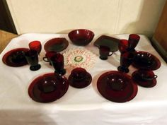 """owner says: """"These Ruby Red dishes belonged to my great grandmother and were given to my Granny when she got married. I remember eating and drinking from them as a child. I recently inherited them and I'm using them daily. I don't believe in letting the """"good dishes"""" sit in a china cabinet collecting dust. And Granny made the doily in the center many decades ago."""""""