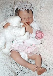"I make incredibly realistic, lifelike, lifesize and miniature baby dolls. I micro-root their hair, paint them to give a three dimensional look to their skin including veining, etc, I weight them with ""baby fat"" pellets, I give them a strong magnet inside their heads which attracts a strong silvery magnet in their pacifiers. I take custom orders too!"