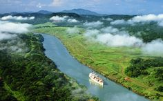 Massive container ships dwarf the panama canal landscape. Image by Will