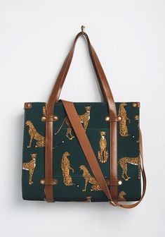 Take a bit of camp charm with you by packing your essentials in this canvas tote! Adorned with brown faux-leather handles, a securely-zipped top, studded. Occasion Maxi Dresses, Leopard Tote, Quirky Fashion, Leather Handle, Cheetah Print, Modcloth, Bag Making, Louis Vuitton Monogram, Women's Accessories