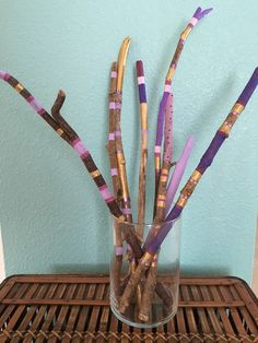Driftwood, hang painted sticks purple and gold