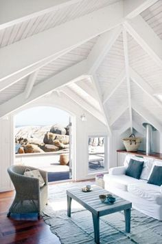 Love the ceiling -looks great all white!  By contrast left the floors natural & sealed 'em.  Doors swing out to patio.