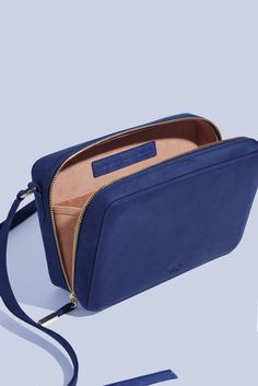 Manufacture Pascal bag, leather crossbody handbag, Lady Officer in Navy Suede, ultra suede inca gold lining, interior gusset, made from 100% American Vegetable tanned leather and handmade in New York.