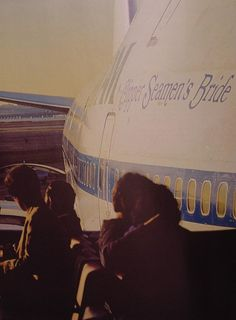 "Large windows and ""nose in"" parking at the Pan Am WorldPort at JFK allowed customers great views of aircraft here 747 Clipper Seamen's Bride is the star on show. Circa 1983."