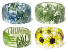 Feathers, shells, leaves, flowers and even bark are encased in resin to create this lovely collection of handmade, resin\u002Dbased jewelry.