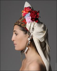 The region was formally known as Roumlouki (land of the Greeks).The characteristic headdresshe from the bridal costume .Photo by Takis Diamantopoulos Greek Traditional Dress, Traditional Outfits, Gypsy Costume, Folk Costume, Macedonia Greece, Greek Beauty, Great Photographers, Headgear, Headdress
