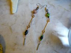 Mismatched Indian Glass Bead Brass Barbell Earrings by cherokeedancing. Explore more products on http://cherokeedancing.etsy.com