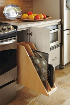 Our Pull Out Tray Divider easily accommodates oversize items, and the pull out tray brings everything right to you.