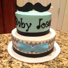 Mustache, chevron, and bow tie gray and blue baby shower marble cake.  https://www.facebook.com/sweetnsassycakesbyeva