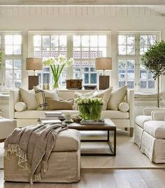 Love the look/layout: linen slip covered ottomans instead of chairs. 2 chairs slightly darker than sofa or vice versa