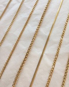 Assorted gold chain necklaces for layering 💛Shop this collection at www.thehe… Assorted gold chain necklaces for layering 💛Shop this collection Gold Chain Design, Gold Jewellery Design, Gold Earrings Designs, Necklace Designs, Pandora Leather Bracelet, Pandora Bracelets, Gold Jewelry Simple, 18k Gold Jewelry, Gold Chains For Men