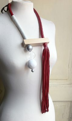 """CAPPIO"" neckpiece by Anna Maria Cardillo, leather, rafia, cotton, glass, wood."