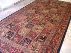 Kashan Persian Carpet. Motifs of Birds an flowers. Beautifully patterned borders.