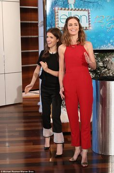 Sophistocated: Emily sported a red jumpsuit as Anna donned a black top and matching trousers with white trim