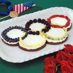 Olympic Rings Fruit Pizza Recipe - Recharge the kids with a table full of nutritious food. They'll get a kick of this yummy Olympic Rings Fruit Pizza.