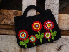 Ravelry: Crochet bag with applique flowers pattern by The Lazy Hobbyhopper