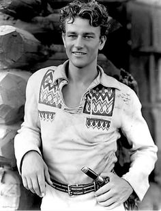 These photos, found by Retronaut, are from IMDB's page on a movie called The Big Trail. Filmed in 1930, it was John Wayne's first headlining role. He played a fur trapper bent on revenge for the murder of his partner and falls in love with a young Ruth (Marguerite Churchill) along the route to Oregon to catch the killers.