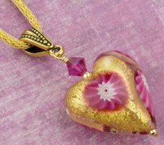 Free Design and Instructions for this Pink Millefiori Heart Pendant. Just one wire wrap stands between you and this Valentine's Day Heart necklace. Also available in silver foil with matching components. Enjoy!