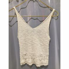 Brandy Melville white knitted tank White knitted tank, looks best braless, very cute but small Brandy Melville Tops Tank Tops
