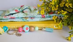 This hand painted keyring was created to match a beautiful printed headband made by According to Alana. It features bright and vibrant colours which are sure to make a statement. Find her headbands here:  https://www.etsy.com/au/shop/AccordingToAlana  http://www.accordingtoalana.com.au/  Violets and Poppies products are lovingly handmade in a home in Sydney, Australia. Each bead is individually painted by hand, with all aspects of design carefully consi...