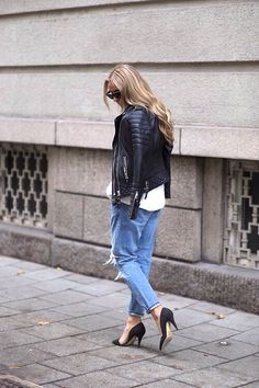 White top, biker jacket, blue jeans