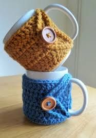Handmade Crochet Mug Cozy Perfect for a hot chocolate on a cold winter night, or your tea or coffee on a crisp winter morning :) Fastens together under and above the handle with a simple wooden button Suitable for straight mugs Crochet Coffee Cozy, Coffee Cup Cozy, Crochet Cozy, Crochet Gifts, Cute Crochet, Coffee Girl, Coffee Corner, Coffee Creamer, Crochet Mignon