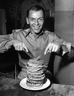 Frank Sinatra eating pancakes on the set of From Here to Eternity, directed by Fred Zinnemann. Donald Pleasence, Michael Bolton, Jodie Foster, John Travolta, Jim Carrey, Judy Garland, Janis Joplin, Michael Myers, Vintage Hollywood