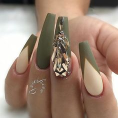 Long coffin shaped nails with olive green french tips and over sized drop shaped rhinestones with matte top coat. Beautiful nails by @fiina_naillounge  ✨Ugly Duckling Nails page is dedicated to promoting quality, inspirational nails created by International Nail Artists  #nailartaddict #nailswag #nailaholic  #nailart  #nailsofins