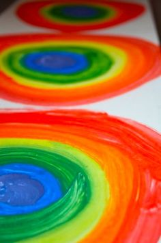 The COOLEST way to make a rainbow.  Fun and easy art technique for kids!  We made a bunch, and strung them into a banner for our playroom. - Happy Hooligans