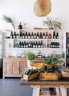 market produce and wine for sale inside botanica restaurant in los angeles, california. #wine #produce #market #productdisplay #farmersmarket #winebar #botanica #silverlake #losangeles #california #shelving #farmtable