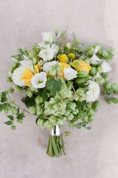 Love the look (free flowing) of this bouquet but with a pop of orange instead of yellow and wheat added.