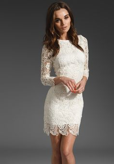 This would be a great rehearsal wedding dress for the spring.    Eryn Brinie lace dress.