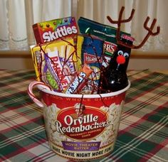 Idea for popcorn and Holiday movie night... would do popcorn bucket and cokes with the reindeer decorations and just one sweet snack like raisinettes
