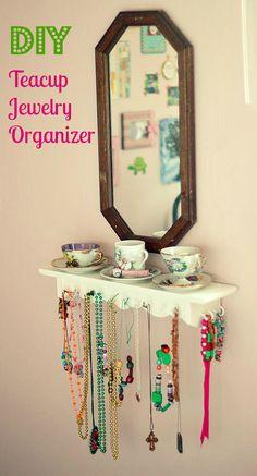 diy teacup jewlery organizer shelf and thrifted mirror