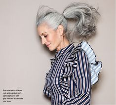 Woman with long, glossy grey hair in a ponytail