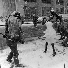 Photographer Paul Mainor makes fashion shots in flurries as model Sherry Lewis braves the cold April 1987. Photo by Jose More #chicagoweather #aprilflurries #1980s #gettheshot by vintagetribune