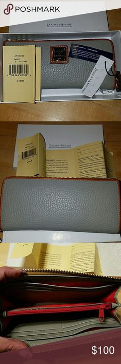 Dooney & Bourke wallet New in box. Comes with registration card. Color is called smoke. It's grey and brown on outside. Red lining on inside. 4x8x2. Great for a gift! Dooney & Bourke Bags Wallets