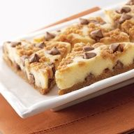 Peanutbutter Cheesecake Bars 2 1/2 cups graham cracker crumbs 3/4 cup (1 1/2 sticks) butter, melted 3/4 cup granulated sugar, divided 1 2/3 cups (10-oz. pkg.) NESTL TOLL HOUSE SWIRLED Milk Chocolate  Peanut Butter Morsels, divided 2 pkgs. (8 oz. each) cream cheese, softened 1/4 cup all-purpose flour 1 tablespoon vanilla extract 4 large eggs