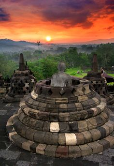 Buddha staring at the sun. Borobudur is one of the greatest Buddhist monuments of the world compared only with Ankor Wat in Cambodia and Bagan in Myanmar. It is located in the region of Central Java, Indonesia (the heart of Javanese culture) by Cretense Places Around The World, Oh The Places You'll Go, Places To Travel, Places To Visit, Around The Worlds, Phnom Penh, Angkor, Beautiful World, Beautiful Places