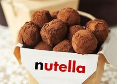 Nutella Truffles:1/4 cup of black chocolate chips ,1/4 cup Nutella 1/4 cup heavy cream ,2 tablespoons unsalted butter ,Cocoa powder for dusting Put the black chocolate, Nutella, cream and butter in a bowl.Place bowl in a double boiler and heat until melted everything, mix to obtain a homogeneous and transferred to a Pyrex container, refrigerate at least 2hrs.After cooling the dough form into balls and coat with cocoa powder.