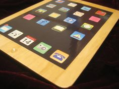 A wooden tablet/iPad toy that we made for the kids, and are selling as well.  Check it out.