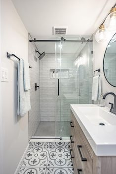 """A basement bathroom renovation welcomes a new guest in this Virginia ranch home. When Nicole's sister decided to move back to the east coast, this Sweeten homeowner decided it was the perfect time to transform her """"creepy and unwelcoming"""" basement bathroom into an open, dreamy bath! 🚿🌟 Shower Floor Tile, Shower Faucet, Sink Faucets, Bathroom Renovations, Bathrooms, Glass Porch, White Washed Oak, Frameless Sliding Shower Doors, Glass Barn Doors"""