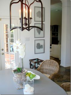 That lantern pendant! (I think that's what I'll replace the current boring light fixture with) and orchids in breakfast nook