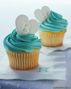 vanilla cupcakes with blue butter icing