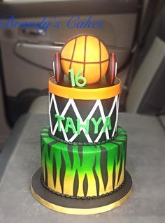 Sweet sixteen, basketball themed cake with Baylor colors.  Basketball is made from cereal treats and sporting Beats headphones. Cake by Brandy's Cakes in Weatherford, TX.