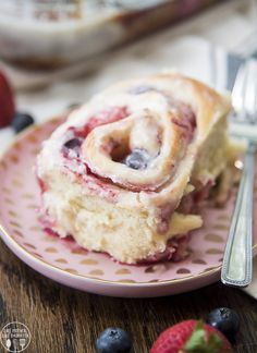 These simple fluffy and soft mixed berry sweet rolls are so easy to make and absolutely delicious filled with a sweet berry filling and topped with a delicious vanilla sugar glaze.