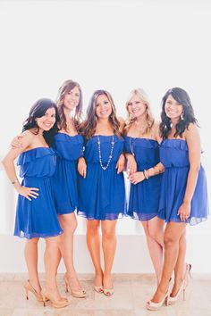 Short blue dresses for the bridesmaids give a pop of colour to a beach wedding in Mexico