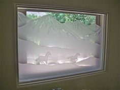 Galloping in the Vistas II - etched glass window carved glass horses galloping in the desert by Sans Soucie Art Glass.