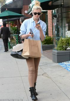 It seems young people cannot go more than a few minutes without checking their phones.  And Ireland Baldwin certainly lived up to that stereotype when she went cupcake shopping in Beverly Hills on Thursday  The leggy lovely was spotted staring intently at the screen of her smartphone as she sauntered down the street in the well-heeled area of Los Angeles.
